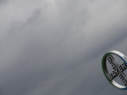A logo of Bayer is seen next to dark clouds at Cologne Bonn airport