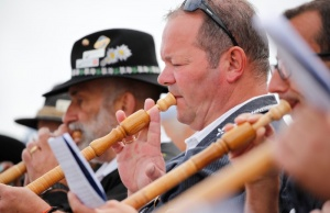 Alphorn blowers perform an ensemble piece on the last day of the Alphorn International Festival on the alp of Tracouet in Nendaz