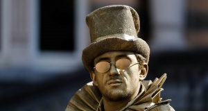 "An artist called ""Levitating Statue"" takes part in the festival ""Statues en Marche"" in Marche-en-Famenne"