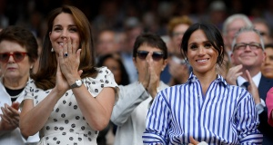 Britain's Catherine, the Duchess of Cambridge, and Meghan, the Duchess of Sussex, applaud after Germany's Angelique Kerber won the women's singles final against Serena Williams of the U.S. at Wimbledon in London