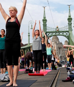 People practice yoga on Liberty Bridge in Budapest