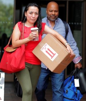 Former New York Daily News newspaper editorial staff members leave the newspaper's offices in New York City after layoffs in New York