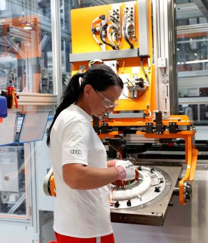 A worker manufactures part of the electric engines at the Audi Factory in Gyor