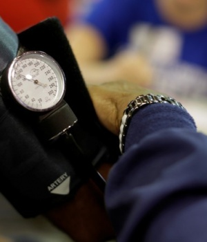 A man has his blood pressure checked at the Remote Area Medical Clinic in Wise, Virginia