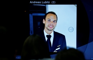 A screen shows a picture of Andreas Lubitz during news conference of Guenter Lubitz in Berlin