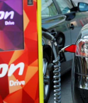 Electric car is charged at the charging station at the front of the German utility E.ON headquarters in Essen