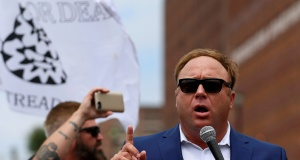 Alex Jones from Infowars.com speaks during a rally in support of Republican presidential candidate Donald Trump near the Republican National Convention in Cleveland