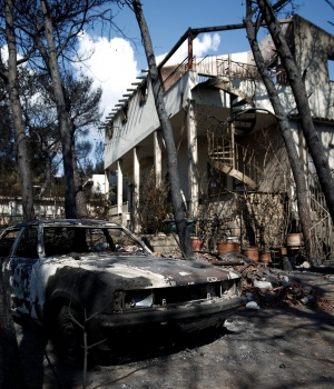 Aristides Katsaros' burnt house is seen following a wildfire in the village of Mati, near Athens