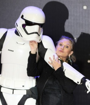 Carrie Fisher poses for cameras as she arrives at the European Premiere of Star Wars, The Force Awakens in Leicester Square