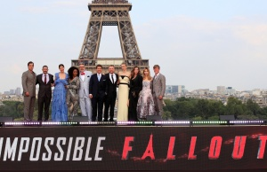 "Director Christopher McQuarrie and cast members pose in front the Eiffel Tower during the world premiere of the film ""Mission: Impossible - Fallout"" in Paris"