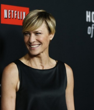 "Cast member Wright poses at the premiere for the second season of the television series ""House of Cards"" at the Directors Guild of America in Los Angeles"