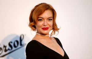 Lindsay Lohan poses upon arrival at the 70th Cannes Film Festival The amfAR's Cinema Against AIDS 2017 event in Antibes