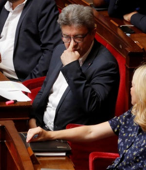 Jean-Luc Melenchon, leader of far-left opposition France Insoumise (France Unbowed) political party, and La France Insoumise members of parliament attend a no-confidence vote against French government at the National Assembly in Paris