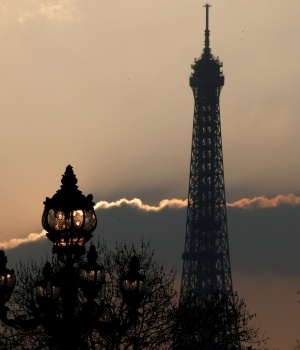 The Eiffel tower is pictured as the sun sets on a winter day in Paris
