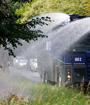 Police water cannon is used to hose water on alley trees in Bochum