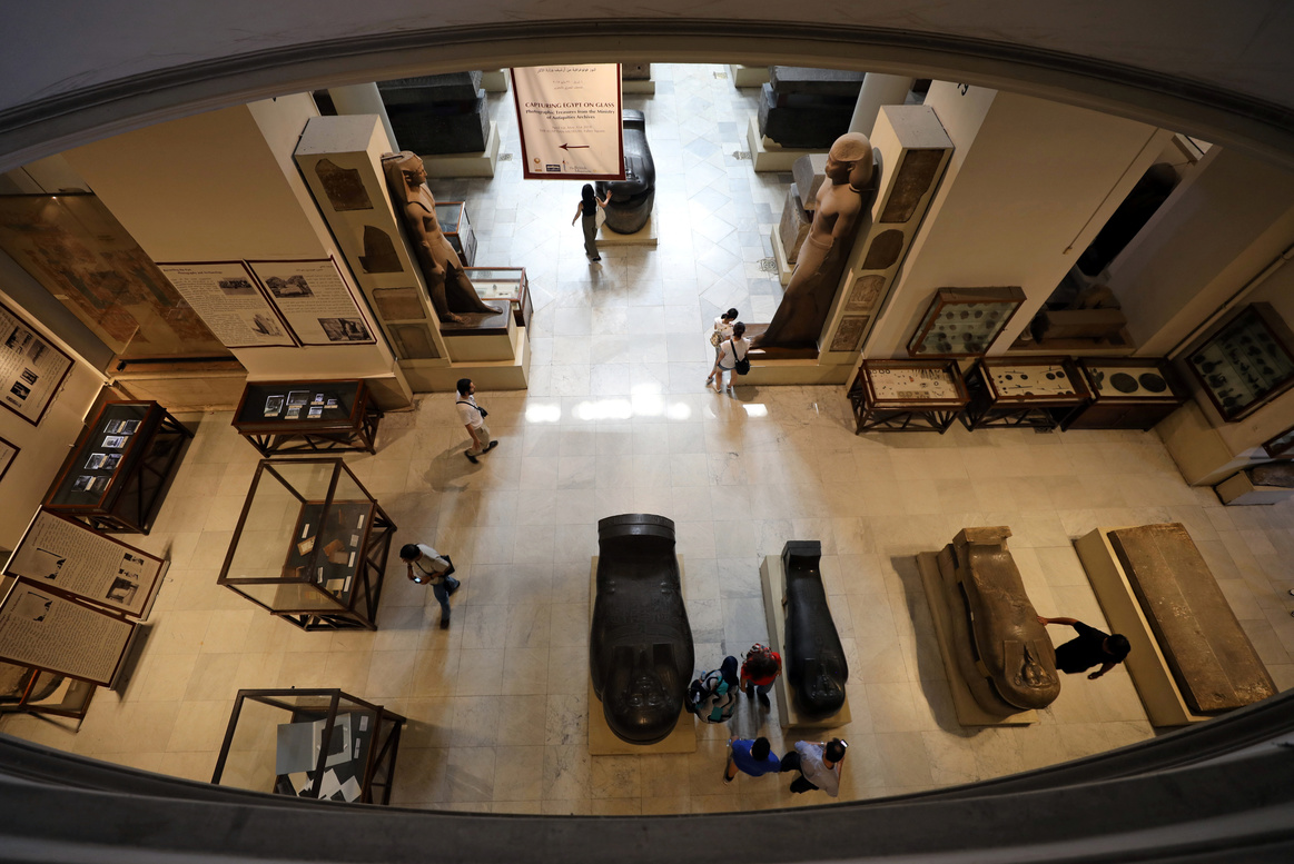 Tourists look at artefacts inside the Egyptian Museum in Cairo