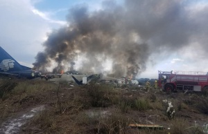 Firefighters douse a fire at the site where an Aeromexico-operated Embraer passenger jet crashed in Mexico's northern state of Durango