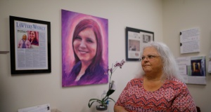 Susan Bro looks at mementos of her daughter Heather Heyer in Charlottesville