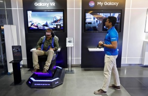 A customer tries a Samsung Gear VR at a Samsung showroom in New Delhi