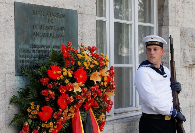 A German honour guard stands at attention at site where group of officers were shot after their failed July 20, 1944 attempt on the life of Hitler, in Berlin