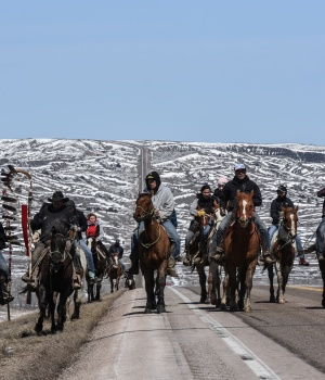A group of the Fort Laramie treaty riders head out in the morning along the local highway on the Cheyenne River Reservation outside of Bridger, South Dakota