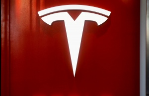 The Tesla logo is seen at the entrance to Tesla Motors' new showroom in Manhattan's Meatpacking District in New York City