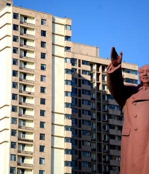 Statue of former Chinese chairman Mao Zedong is seen in front of a residential building in Dandong New Zone