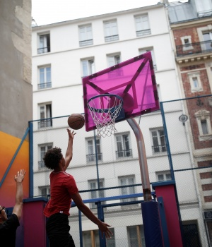 The basketball court Pigalle Duperre, painted in shades of purple, pink, yellow, orange and blue, and with a rubber-surfaced court, is sandwiched into a row of buildings in the 9th arrondissement, is pictured in Paris