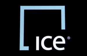 A screen displays the ticker symbol and logo for Intercontinental Exchange Inc. (ICE) on the floor of the NYSE