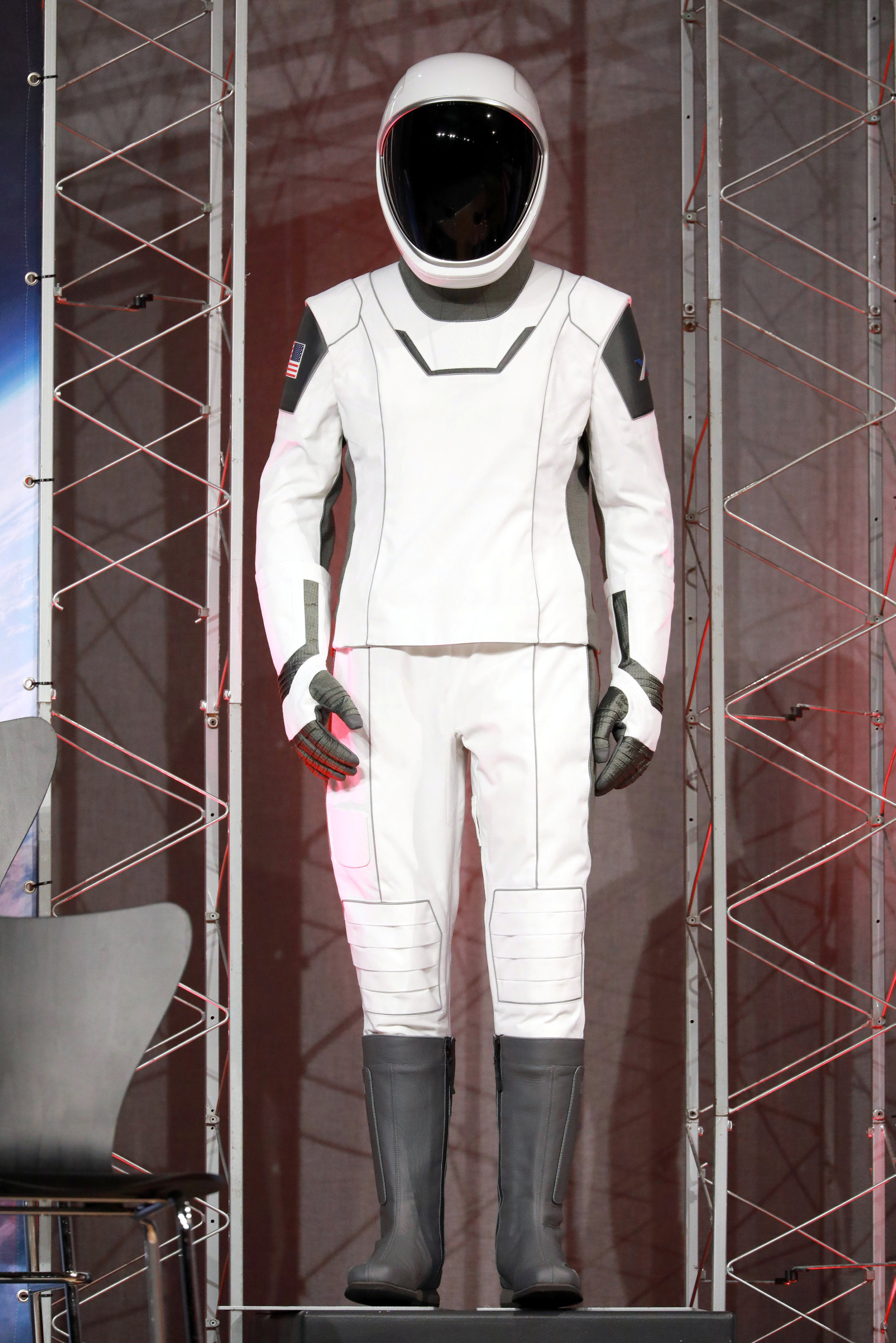 New SpaceX spacesuit displayed as NASA announces crew assignments for Boeing CST-100 Starliner and SpaceX Crew Dragon in Houston