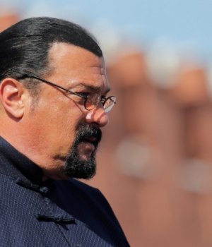 U.S. actor Steven Seagal watches the Victory Day parade at Red Square in Moscow