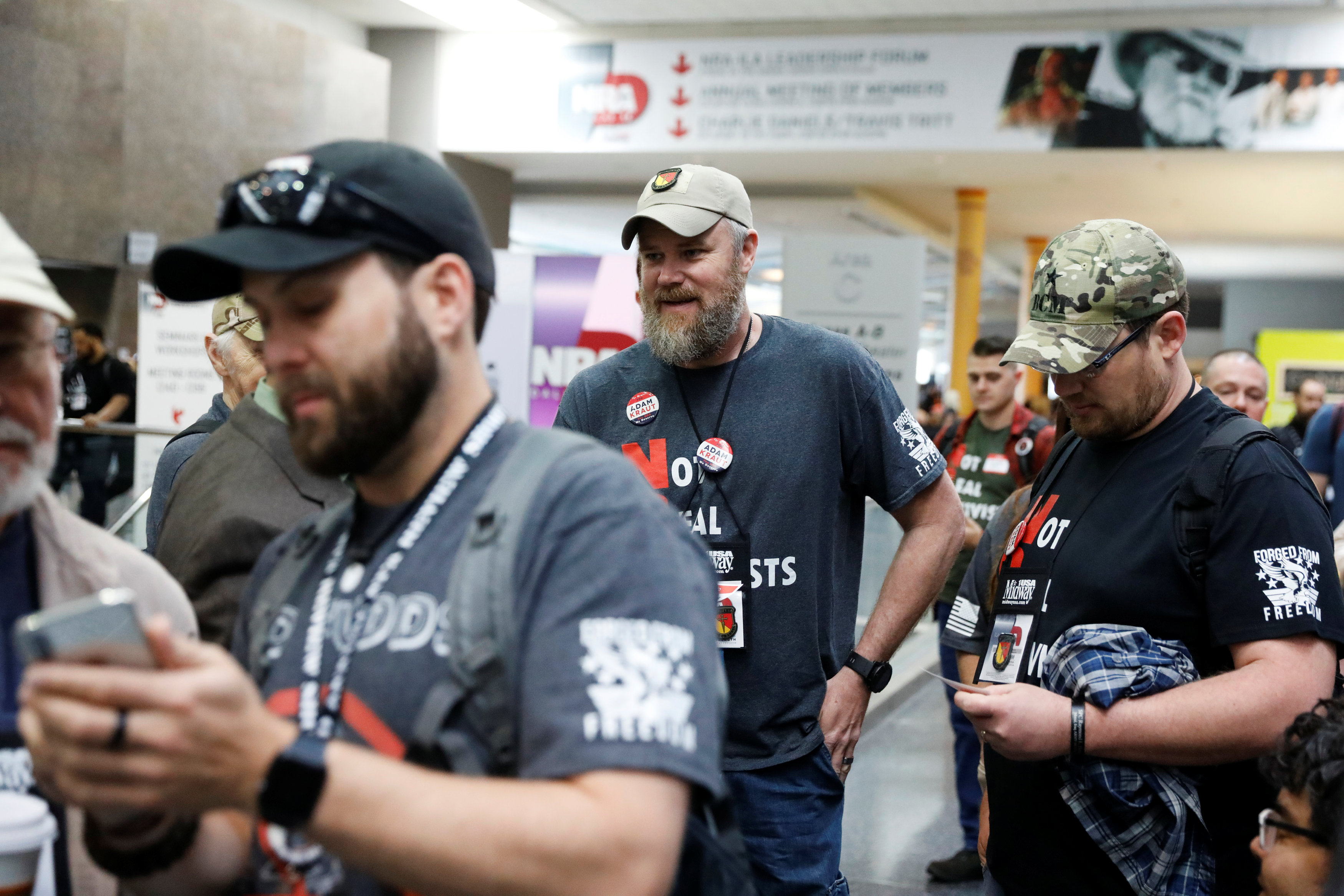 Gun rights proponent Tim Harmsen speaks to NRA members about Adam Kraut's candidacy for a seat on the board of the National Rifle Association (NRA) at the organisation's convention in Dallas