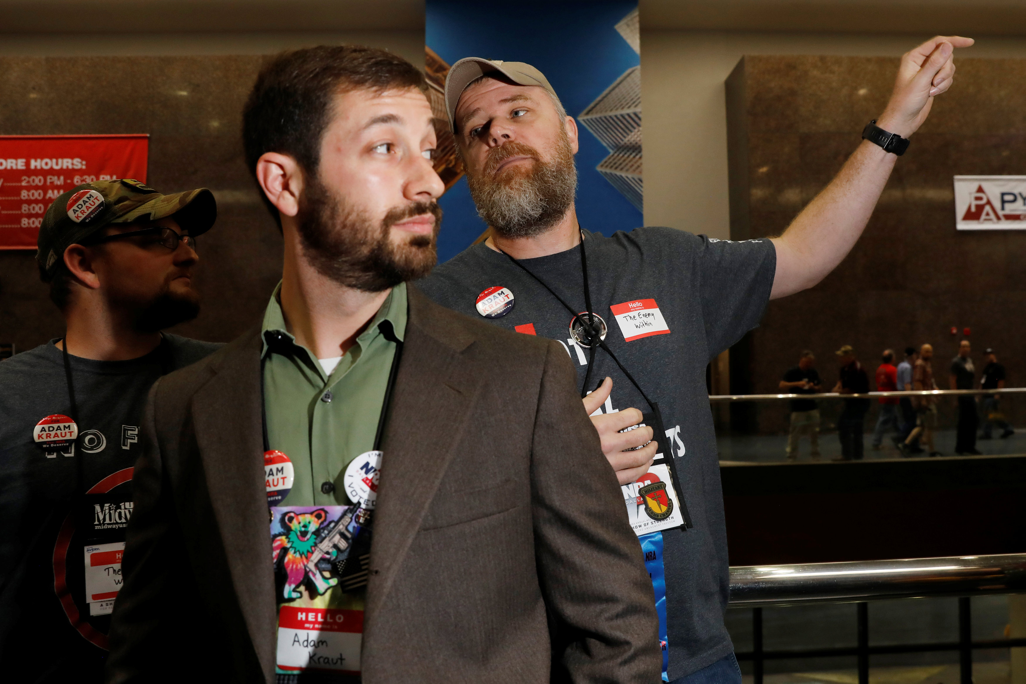 Gun rights proponents Adam Kraut and Tim Harmsen, speak to NRA members about Kraut's candidacy for a seat on the board of the National Rifle Association (NRA) at the organisation's convention in Dallas