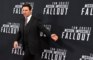 Actor Tom Cruise arrives for Mission:Impossible film premiere in Washington