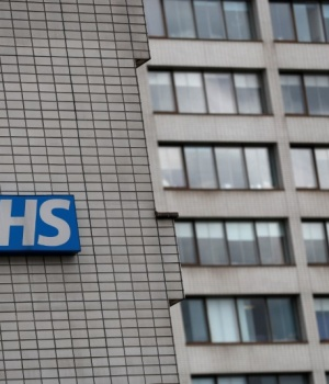 NHS sign is seen at St Thomas' Hospital in central London