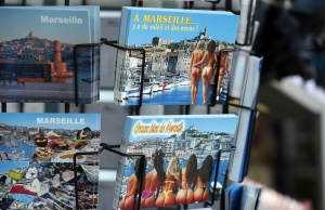 Postcards with pictures of bikini-clad women are seen on display on a postcard stand at a souvenir shop in Marseille