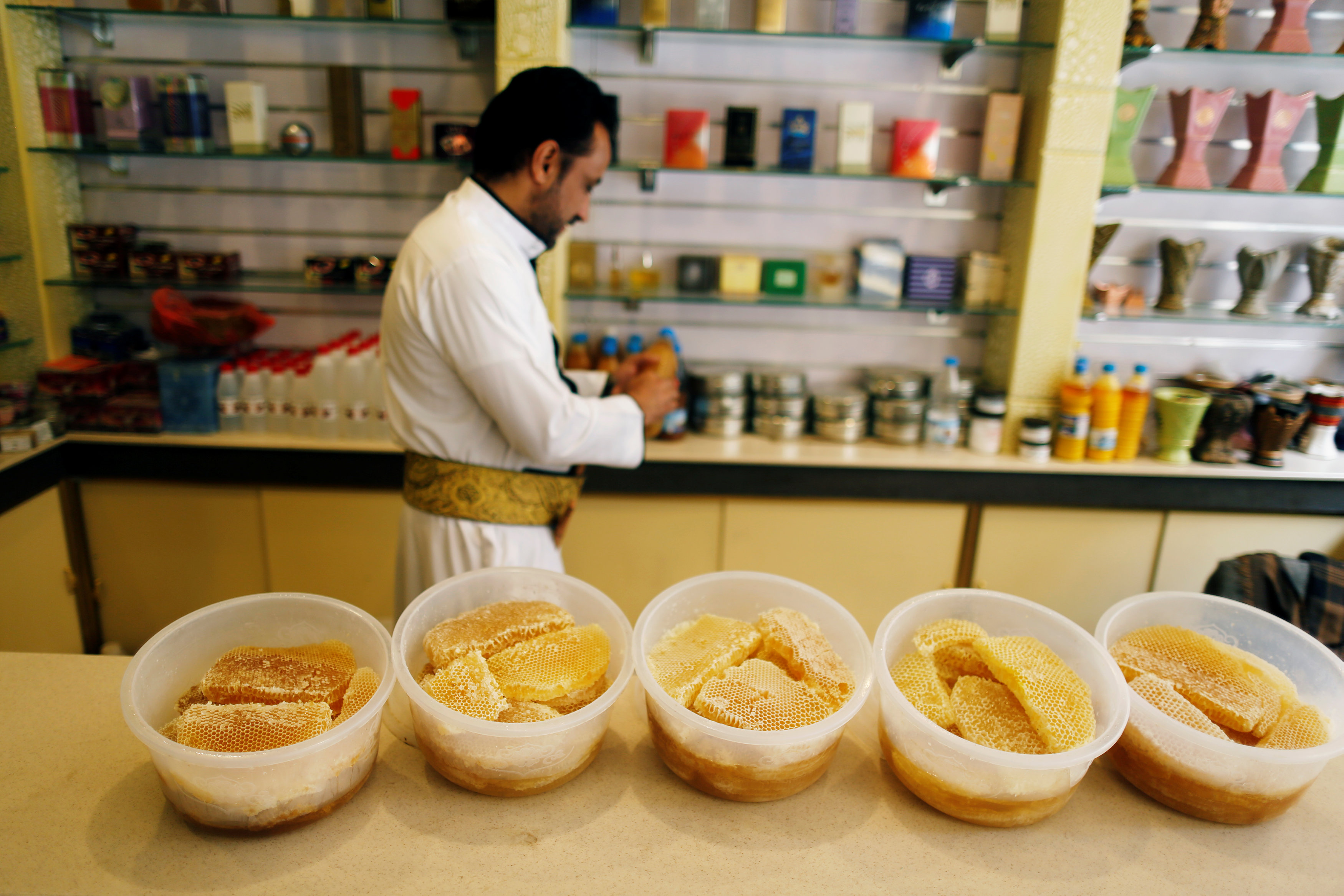 Honeycombs filled with honey are displayed at a honey shop in Sanaa