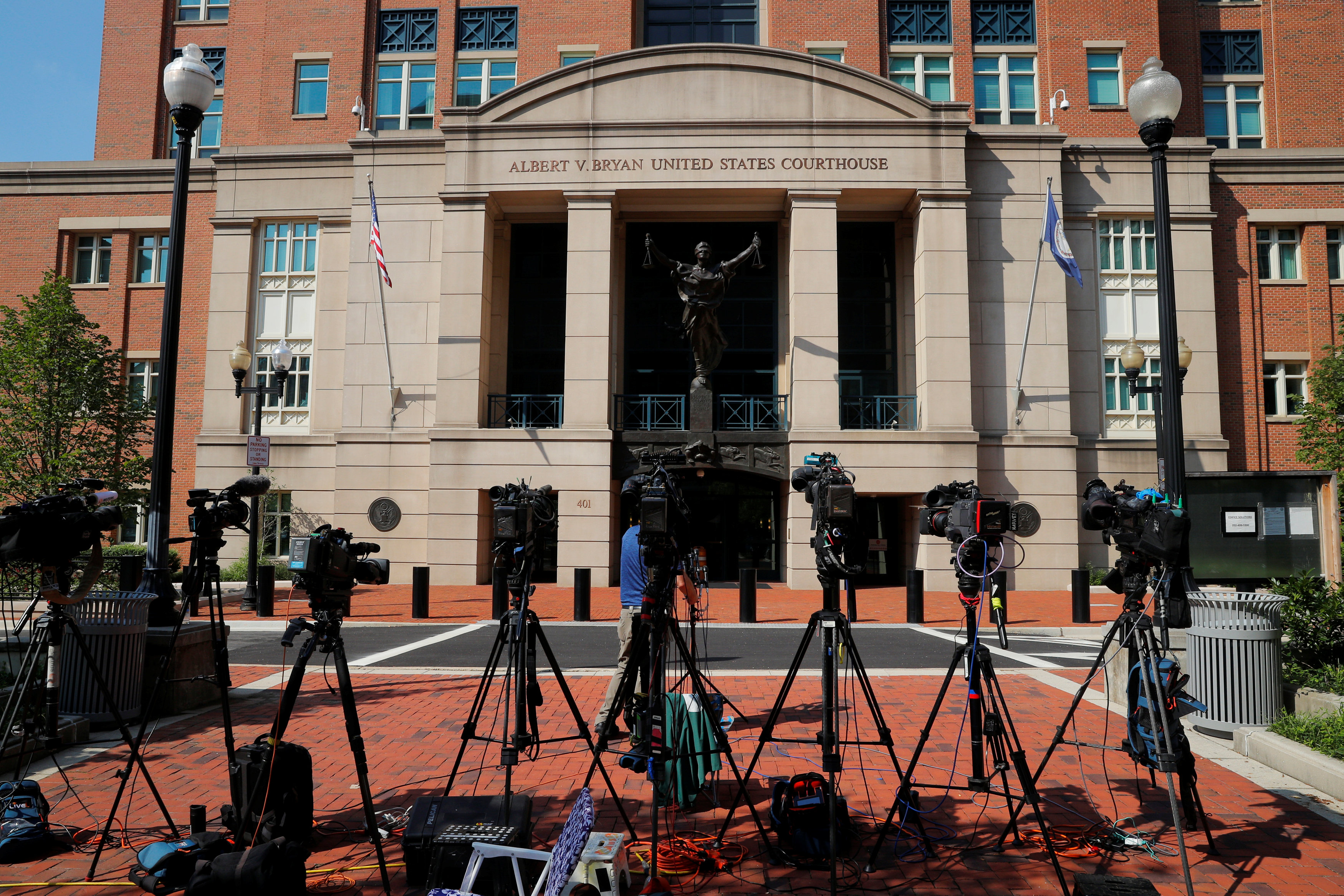 Television cameras are positioned outside the U.S. District Courthouse where Paul Manafort is being tried in Alexandria