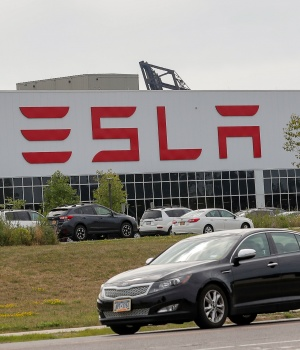 Flags fly over the Tesla Inc. Gigafactory 2, which is also known as RiverBend, a joint venture with Panasonic to produce solar panels and roof tiles in Buffalo, New York