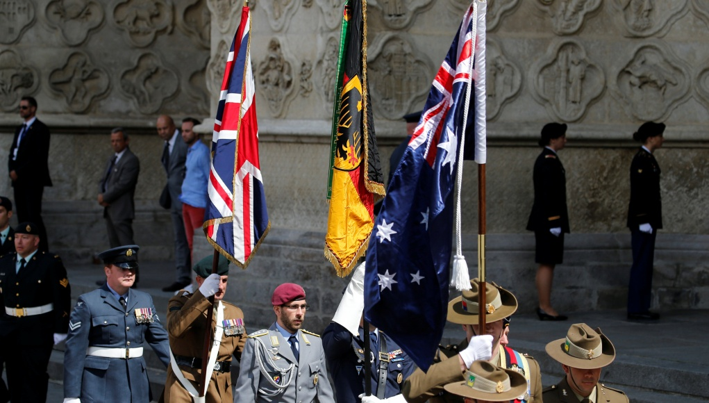 Flag bearers arrive before a religious ceremony to mark the 100th anniversary of the World War I (WW1) Battle of Amiens, at the Cathedral in Amiens