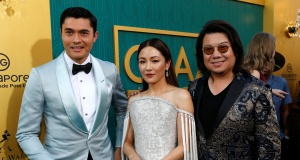 """Author Kwan and cast members Golding and Wu pose at the premiere for """"Crazy Rich Asians"""" in Los Angeles"""