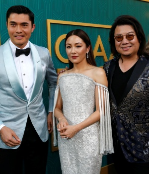 "Author Kwan and cast members Golding and Wu pose at the premiere for ""Crazy Rich Asians"" in Los Angeles"