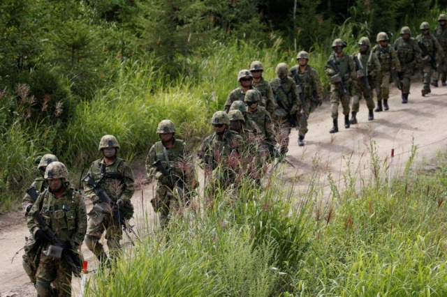 Japan Ground Self Defense Force members take part in their joint exercise, named Northern Viper 17, with U.S. Marine Corps in Eniwa, Japan
