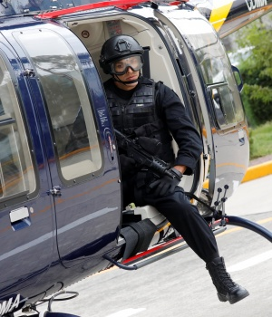 "A police officer, member of a team known as ""Condores"", is seen after a patrol the city, part of a new strategy to combat the crime in Mexico City"