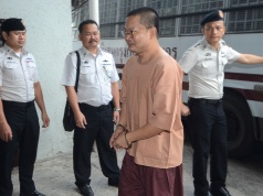 Wirapol Sukphol, former Thai Buddhist monk who provoked outrage with his lavish lifestyle arrives at the Criminal court in Bangkok
