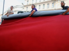 Workers prepare the red carpet for 24th Sarajevo Film Festival in Sarajevo