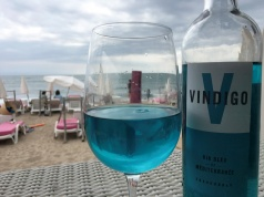 A glass of Vindigo, Mediterranean chardonnay wine, is seen at a beachfront restaurant in Sete