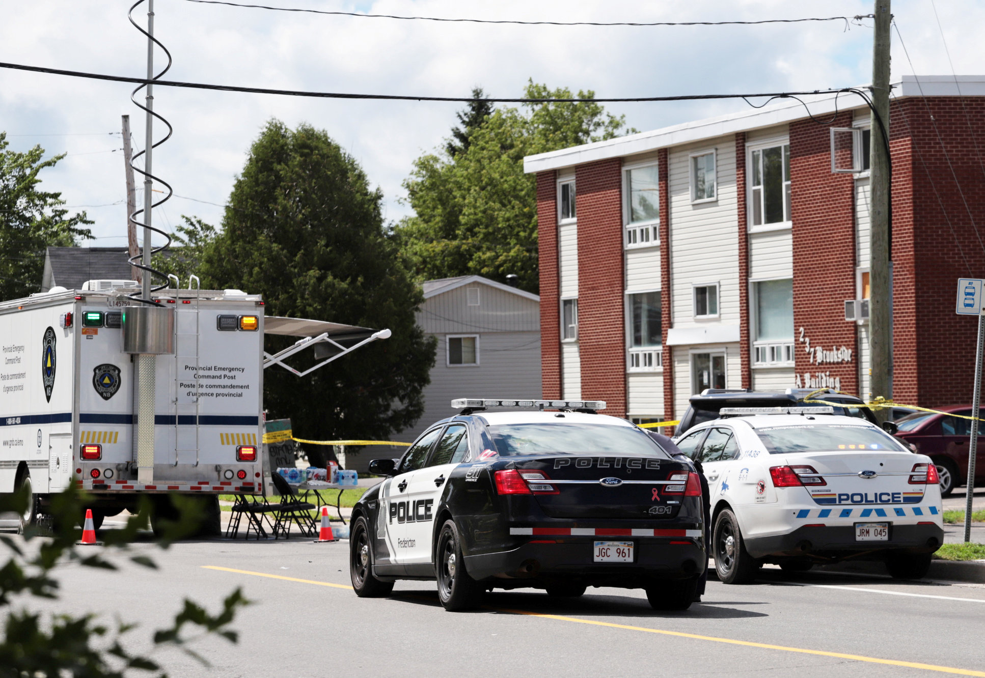 Fredericton Police and Royal Canadian Mounted Police (RCMP) investigate apartment complex which was the scene of a shooting incident in Fredericton