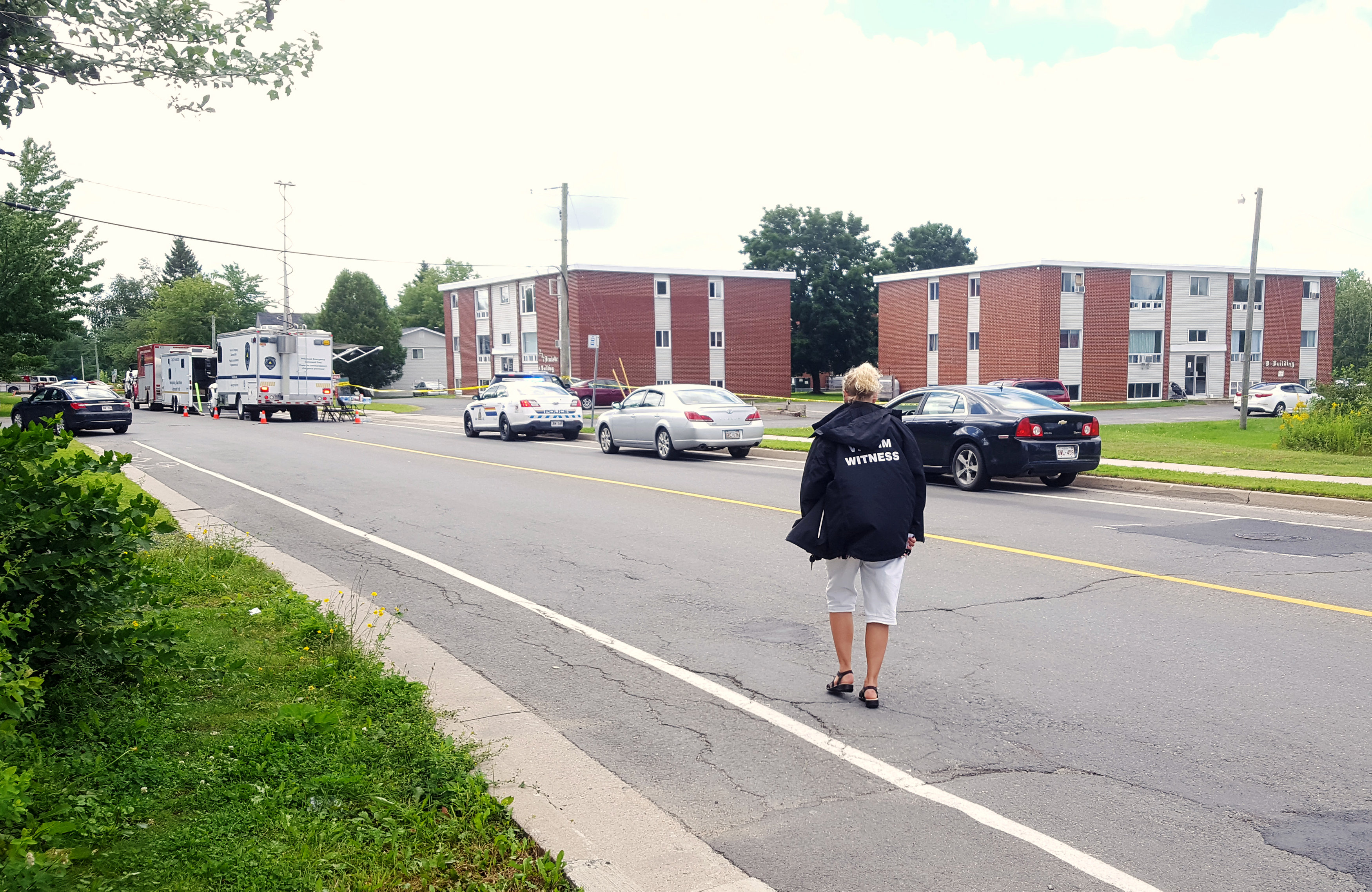 Police investigate the scene of a shooting incident in Fredericton