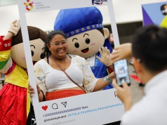 Attendees and K-pop fans participate at KCON USA, billed as the world's largest Korean culture convention and music festival, in Los Angeles